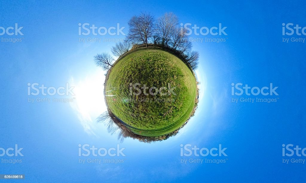 Little planet - spherical view of green fields with trees stock photo
