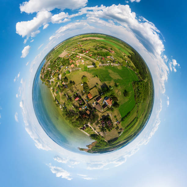 Little planet view of Sniardwy lake and Nowe Guty under blue cloudy sky stock photo