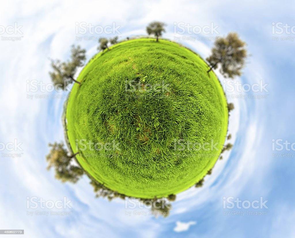 Little planet with clear thick grass lawn stock photo