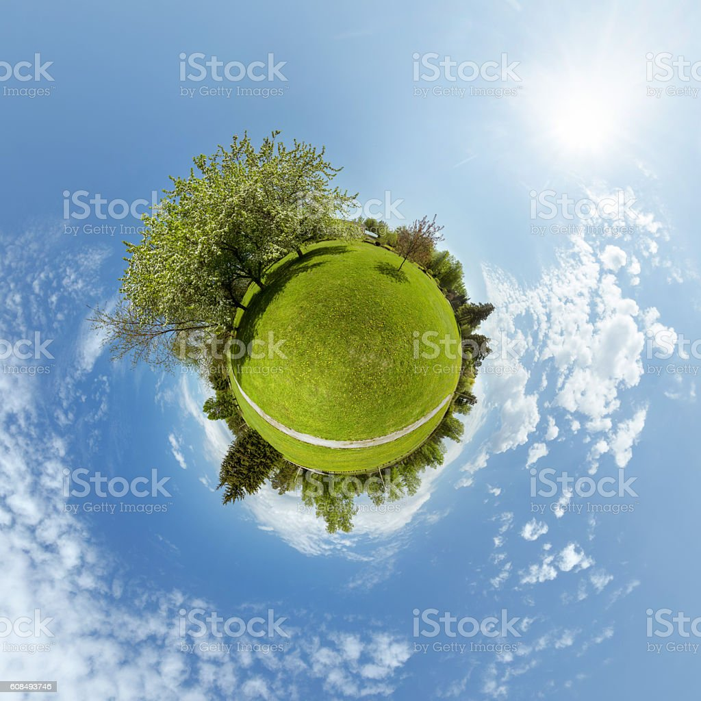 Little planet with trees and green meadow stock photo