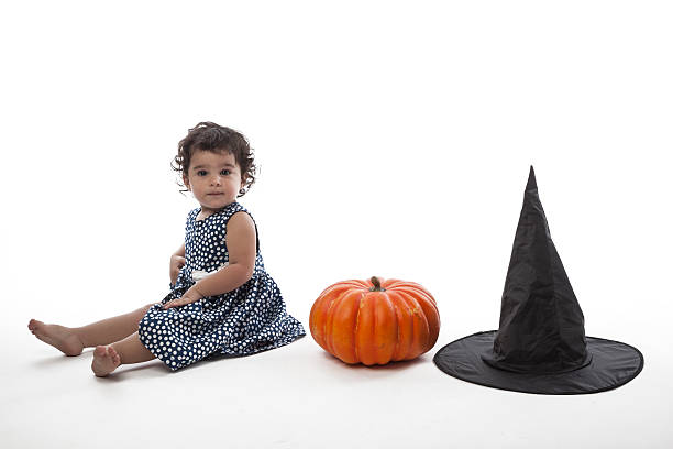 Little playful witch with hat and pumpkin for halloween stock photo · Witch  flies on a broom in the orange ... 1b3c92eb5c91