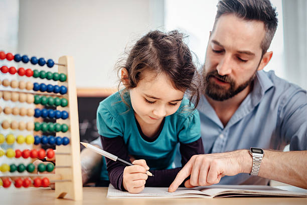 little pre-scholar girl and father learning calculating at home - day in the life series stock pictures, royalty-free photos & images