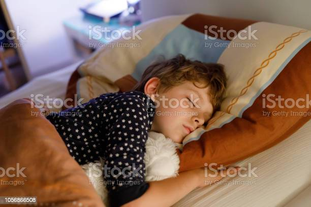 Little preschool kid boy sleeping in bed with colorful lamp picture id1056866508?b=1&k=6&m=1056866508&s=612x612&h=vtuqvnsajxhyrdzcrz ysccudyie vtx7qsfzblgbc4=