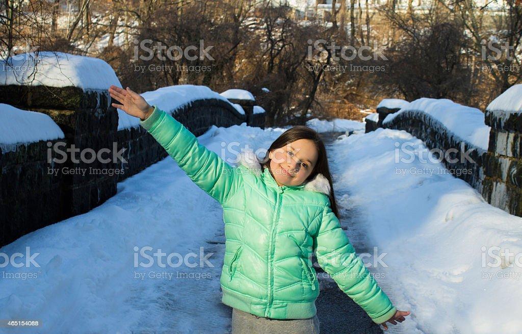 Little pretty girl loves winter. stock photo