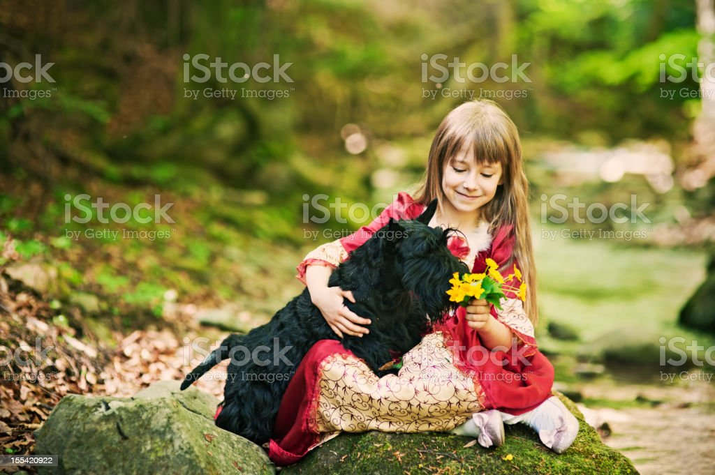 Little princess and her dog royalty-free stock photo