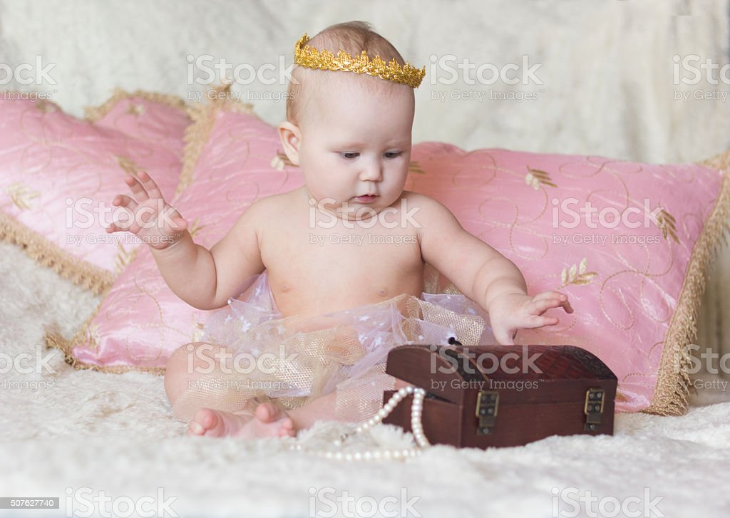 Little princess baby with a box stock photo