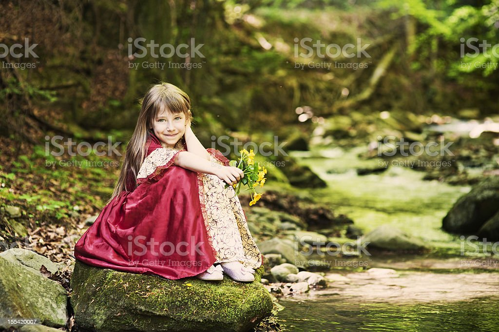 Little princess by the stream stock photo