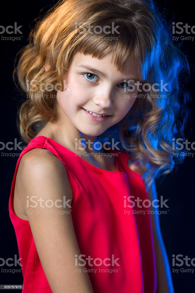 Little princess portrait in red dress stock photo
