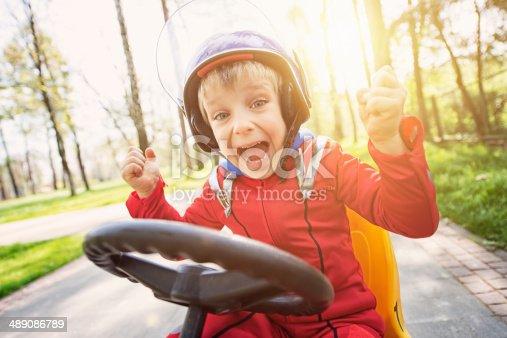 1035136022 istock photo Little racer winning 489086789