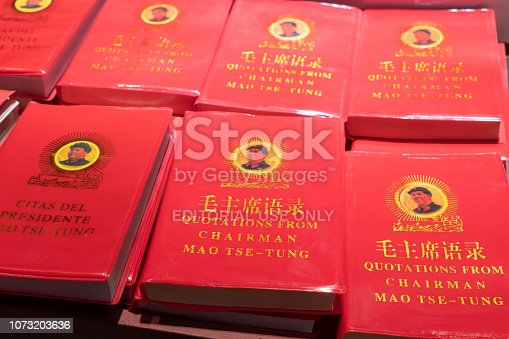 Rows of Chairman Mao's Little Red Book for sale at a market in China.  This book contains statements from speeches and writings of the former Chairman of the Communist Party, and is widely available throughout the country.