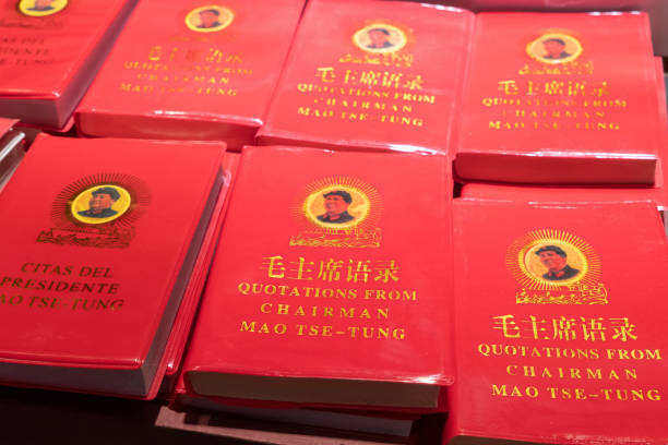 Little Red Book of Quotations from Chairman Mao Tse-tung Rows of Chairman Mao's Little Red Book for sale at a market in China.  This book contains statements from speeches and writings of the former Chairman of the Communist Party, and is widely available throughout the country. mao tse tung stock pictures, royalty-free photos & images
