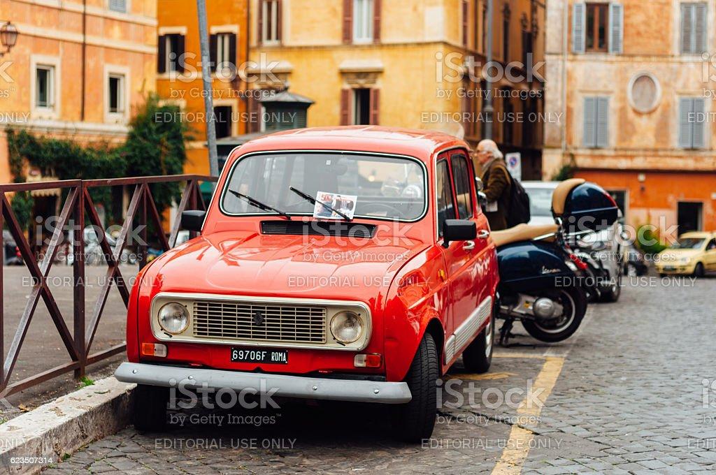 Little red Renault on old italian street stock photo