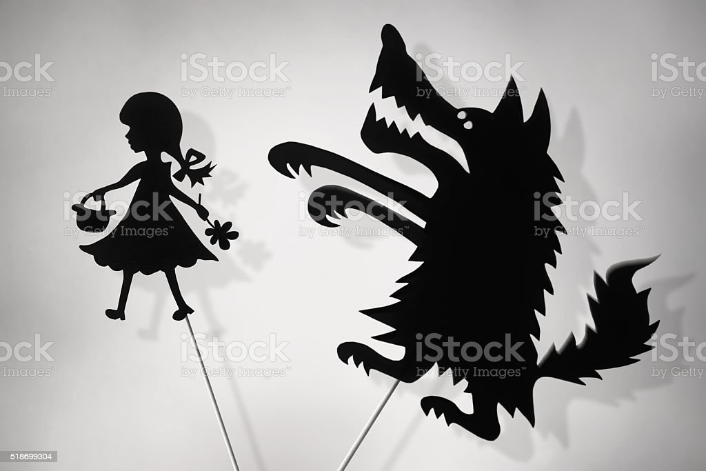 Little Red Riding Hood and Bad Wolf shadow puppets stock photo