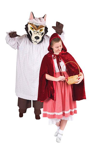 rotkäppchen und großes bad wolf - rotkäppchen kostüm stock-fotos und bilder