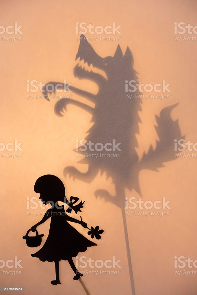 Little Red Riding Hood and the Wolf shadow theater show stock photo
