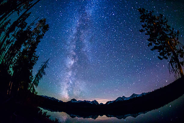 Little Redfish Lake at night Beautiful Little Redfish Lake at night with Sawtooth mountains in the background and star filled sky with milky way. Picture taken with Nikon 16 mm fish-eye lens fish eye lens stock pictures, royalty-free photos & images