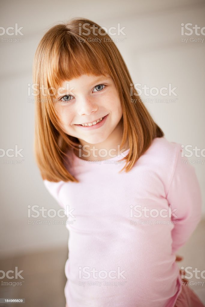 Little Red-Haired Girl Smiling at the Camera stock photo