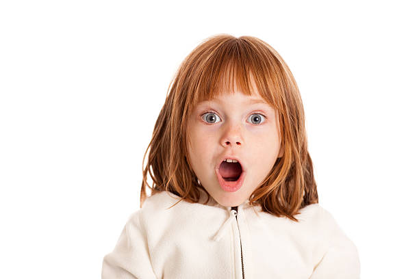 Little, Red-Haired Girl with Surprised Look on White Color photo of a little 4-5 year old girl gasping with a look of surprise on white background. gasping stock pictures, royalty-free photos & images