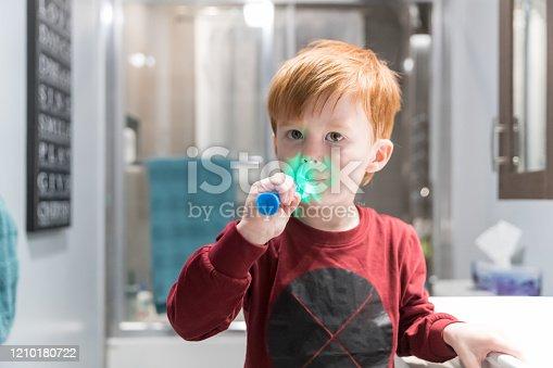 948443044 istock photo Little Redhead Boy Brushing His Teeth 1210180722
