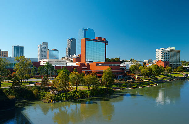 Little Rock skyline with mirrored building and river stock photo