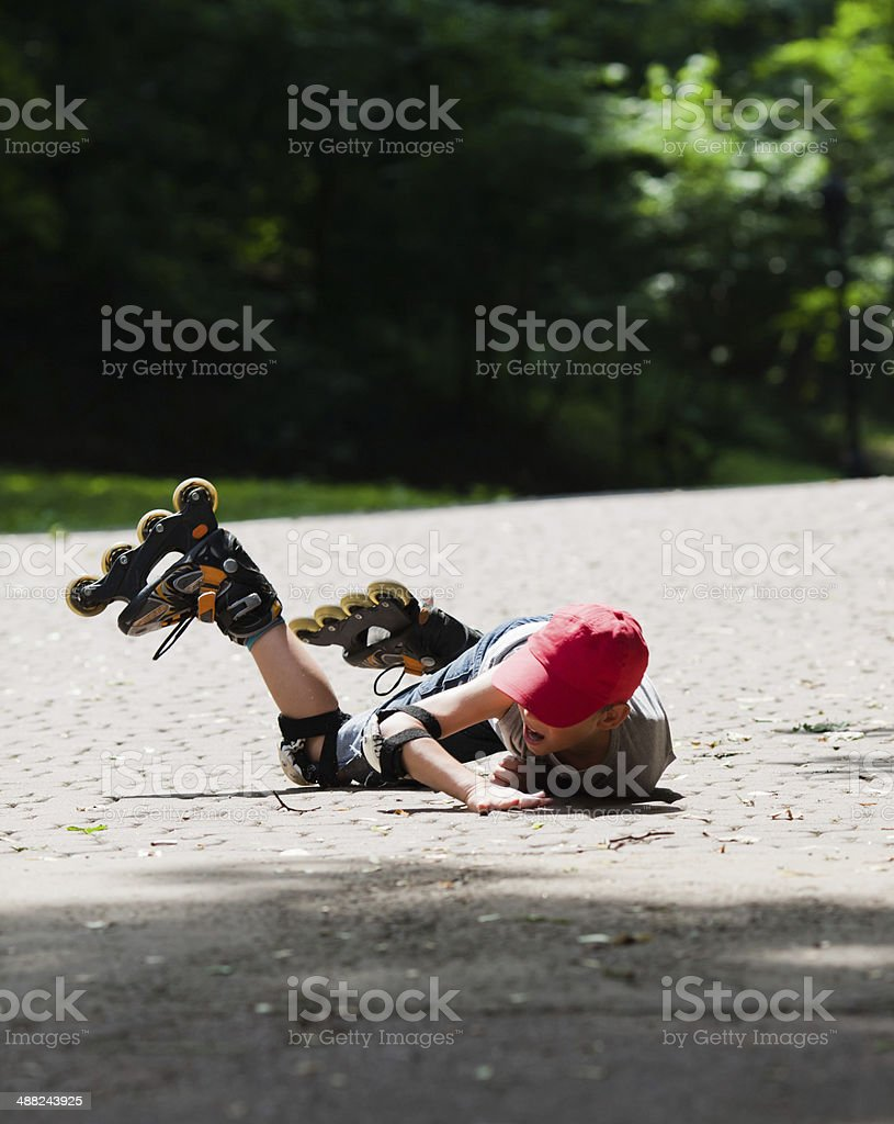 Little rollerblader takes a tumble stock photo