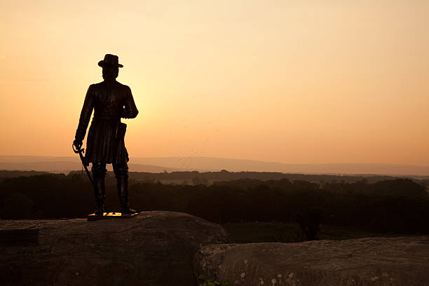 Little Round Top Sunset A sunset from Little Round Top at the Gettysburg National Military Park in Pennsylvania. The statue is of Union General Gouverneur K. Warren errected on August 8, 1888 and created by Karl Gerhardt. american civil war stock pictures, royalty-free photos & images