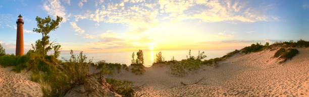 little sable point lightouse panorama - lake michigan stock pictures, royalty-free photos & images