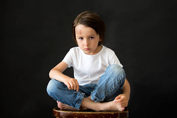 little sad boy with big bump on head from fall - bumpy stock pictures, royalty-free photos & images