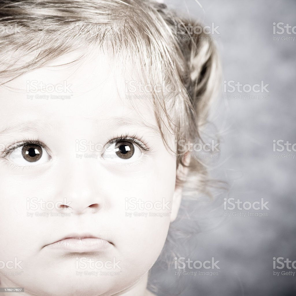Little sad girl looking up royalty-free stock photo