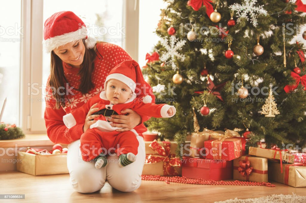 Little Santa and his helper stock photo