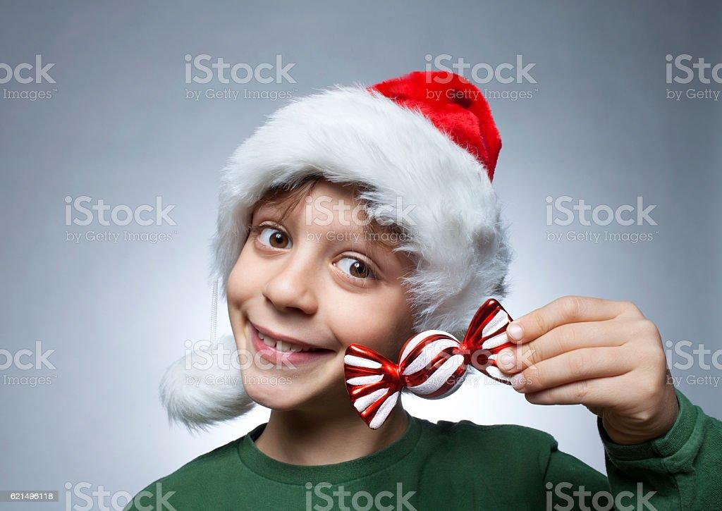 Little Santa Claus with candy photo libre de droits