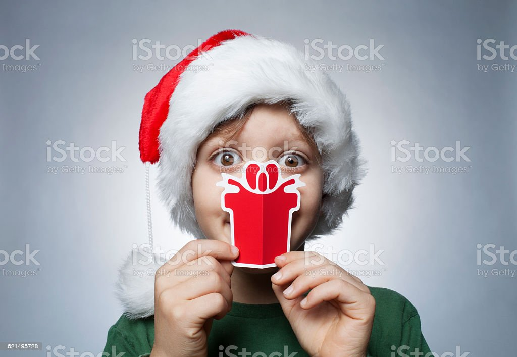 Little Santa Claus with Christmas gift foto stock royalty-free