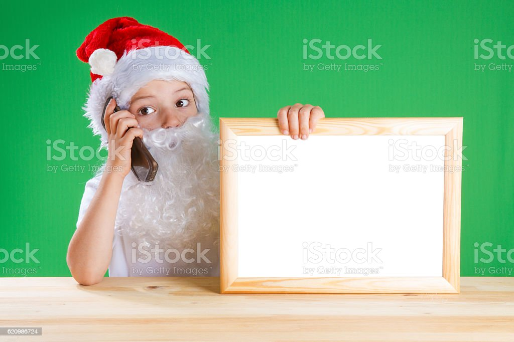 Little Santa holding a blank picture frame with white background foto royalty-free