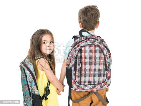 istock Little School Girl And Boy Walking Hand In Hand 486253856