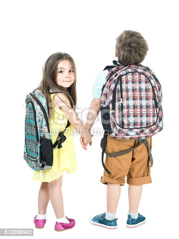 istock Little School Girl And Boy Walking Hand In Hand 510398942