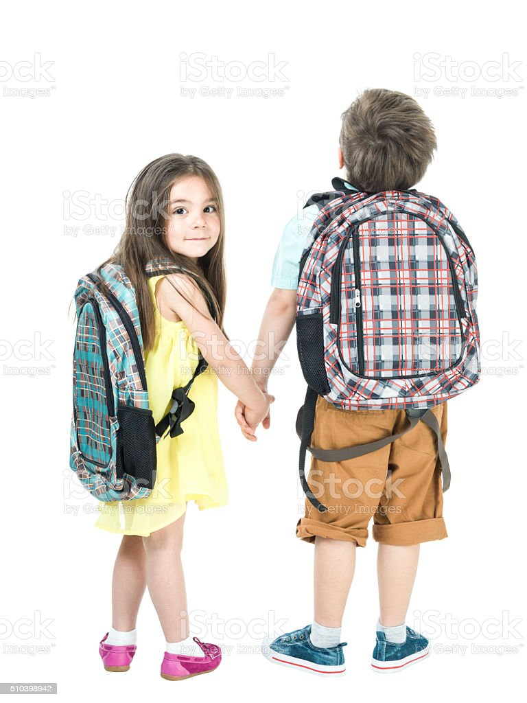 Little School Girl And Boy Walking Hand In Hand stock photo