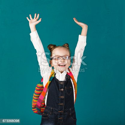 istock Little school girl 673368098