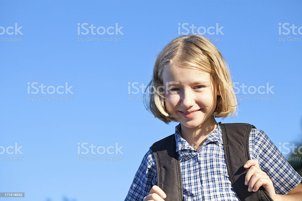 Little School Girl with Blue Background royalty-free stock photo