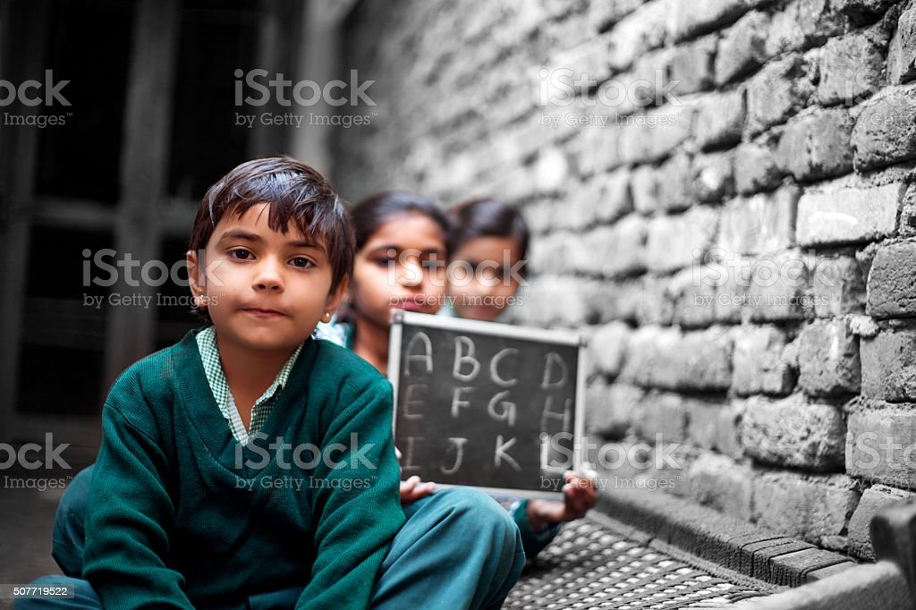 Little School Students portrait at home holding chalkboard stock photo