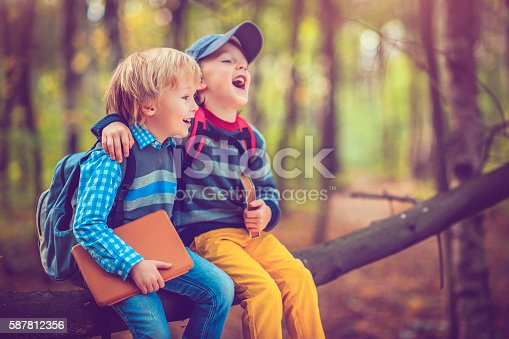 istock Little schoolboys in autumn 587812356