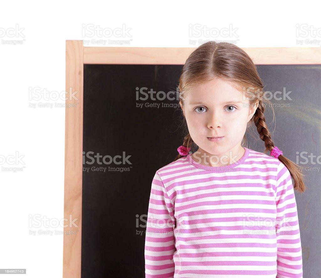 Little schoolgirl and school chalkboard royalty-free stock photo