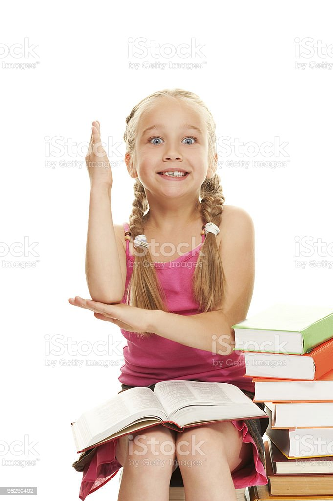 Little schoolgirl raised her hand to answer question royalty-free stock photo