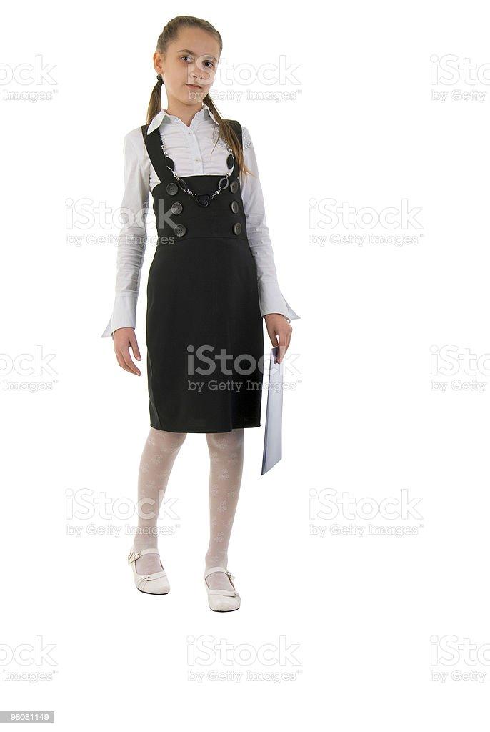 Little giovane studentessa con cartella nero. foto stock royalty-free
