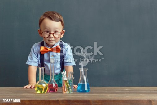Little child in the classroom.