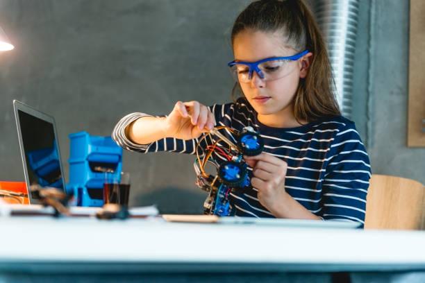 Little scientist working on school project stock photo