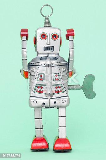 istock little silver robot with hands up 917738274