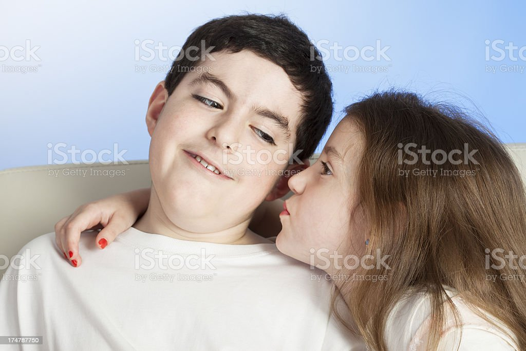 Little sister kissing her brother royalty-free stock photo