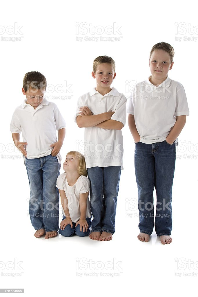 Little Sister Looking Up to Big Brothers royalty-free stock photo