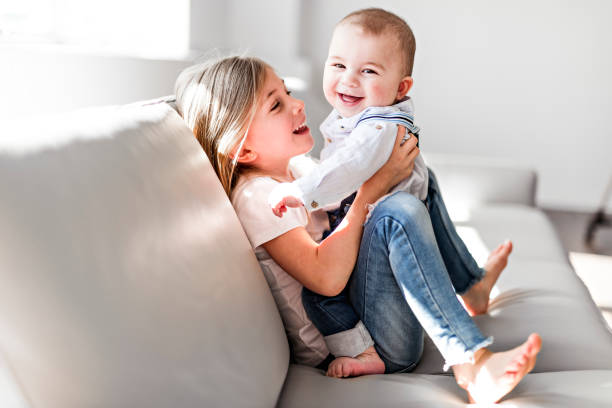 Little sister with her baby brother. Toddler kid Family with children at home. A Little sister with her baby brother. Toddler kid Family with children at home. brother stock pictures, royalty-free photos & images
