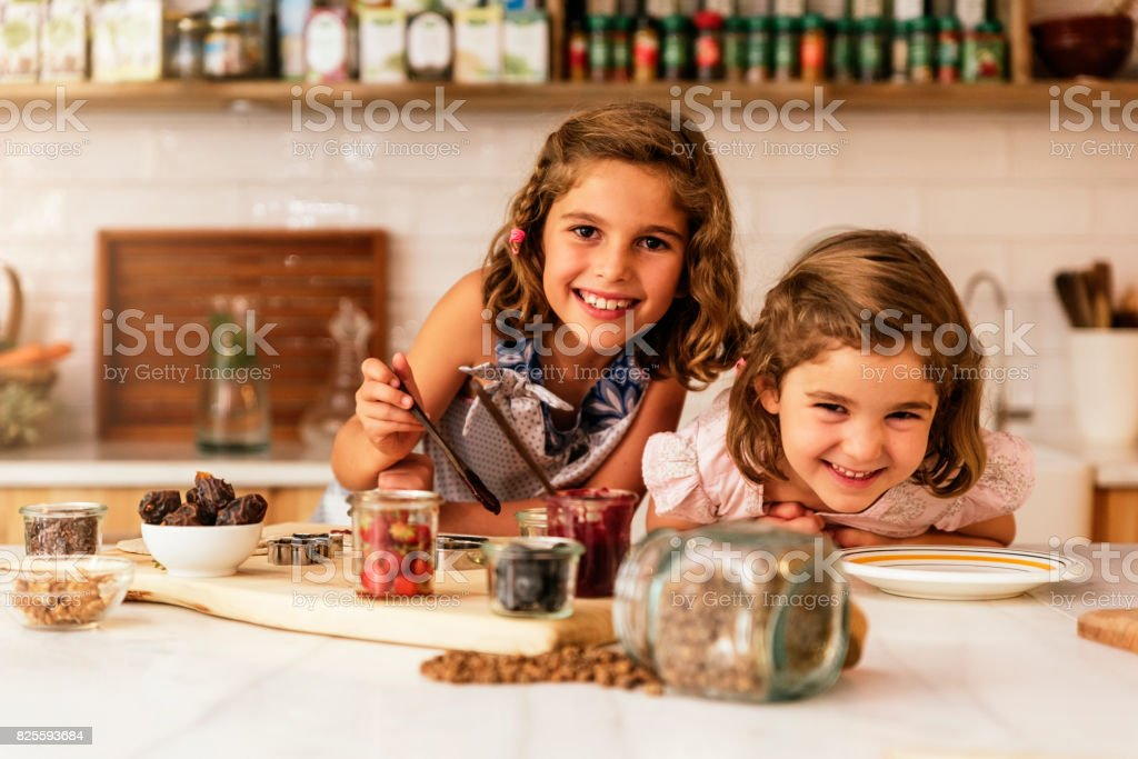 Little sisters girl preparing baking cookies. stock photo
